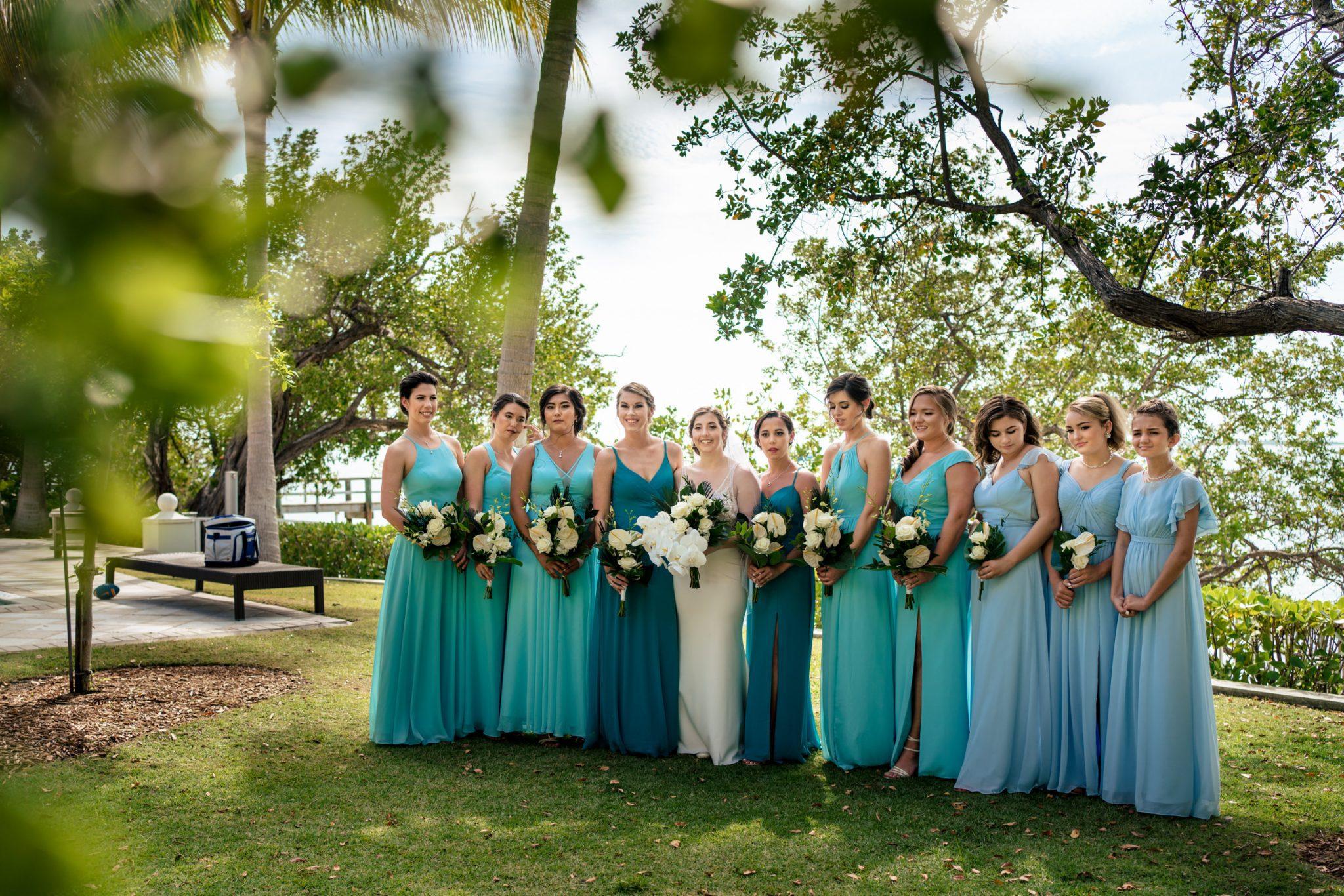 bridesmaids and bride posing for photo waterfront playa largo resort wedding