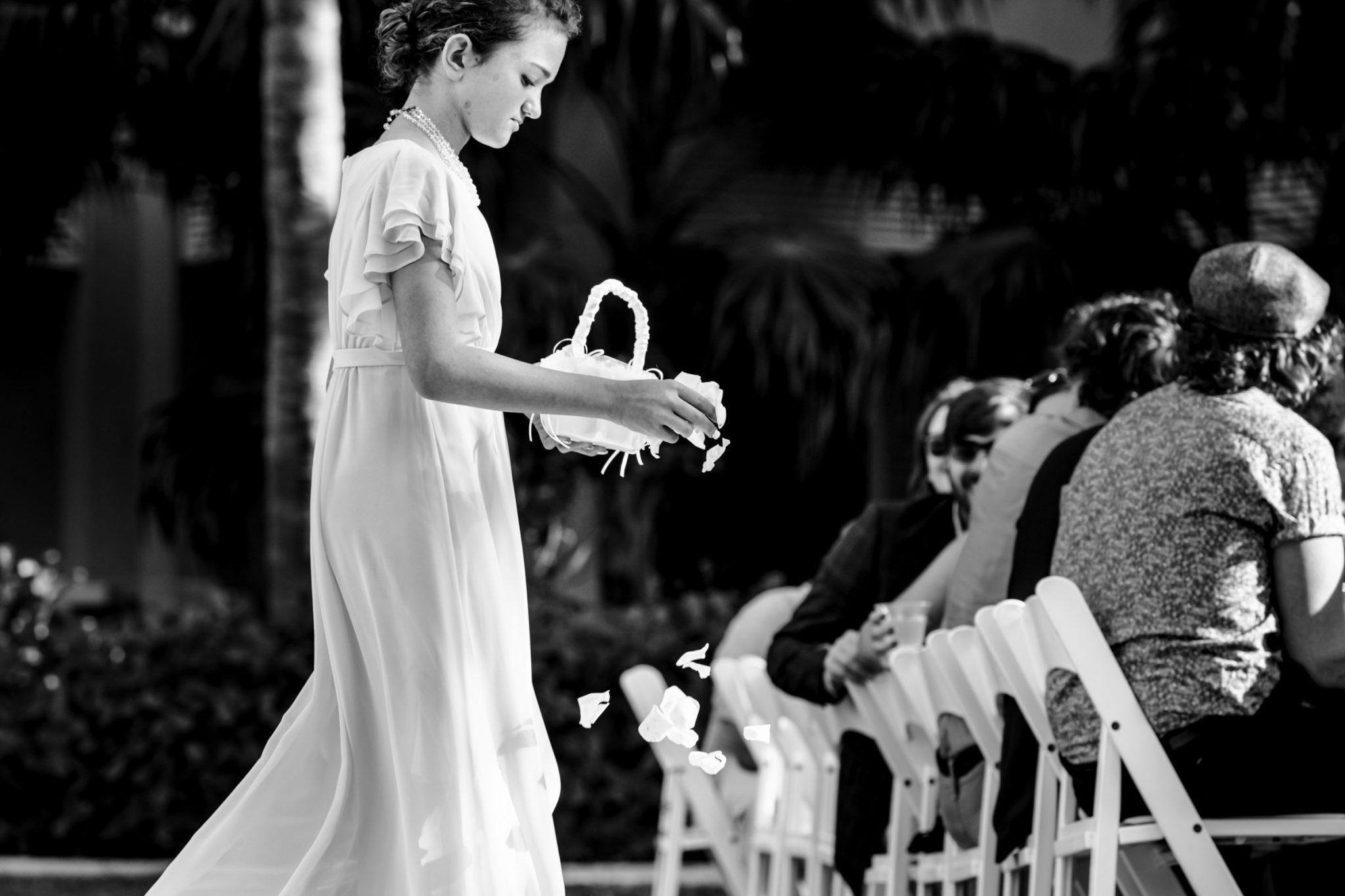 flower girl dropping rose petals playa largo resort wedding