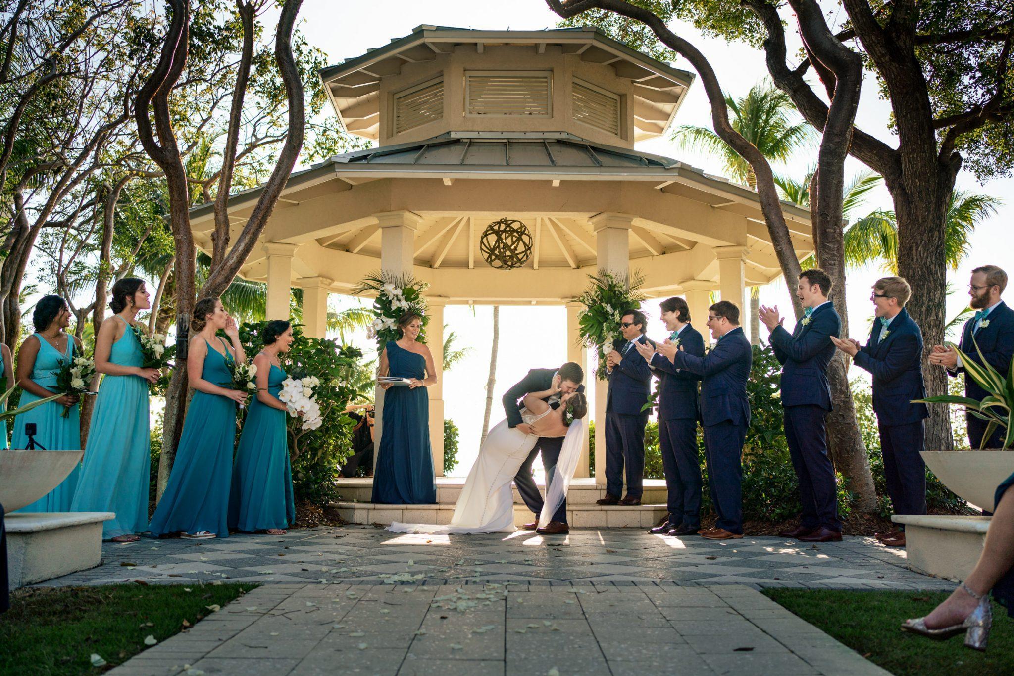 first kiss as groom dips the bride playa largo resort wedding