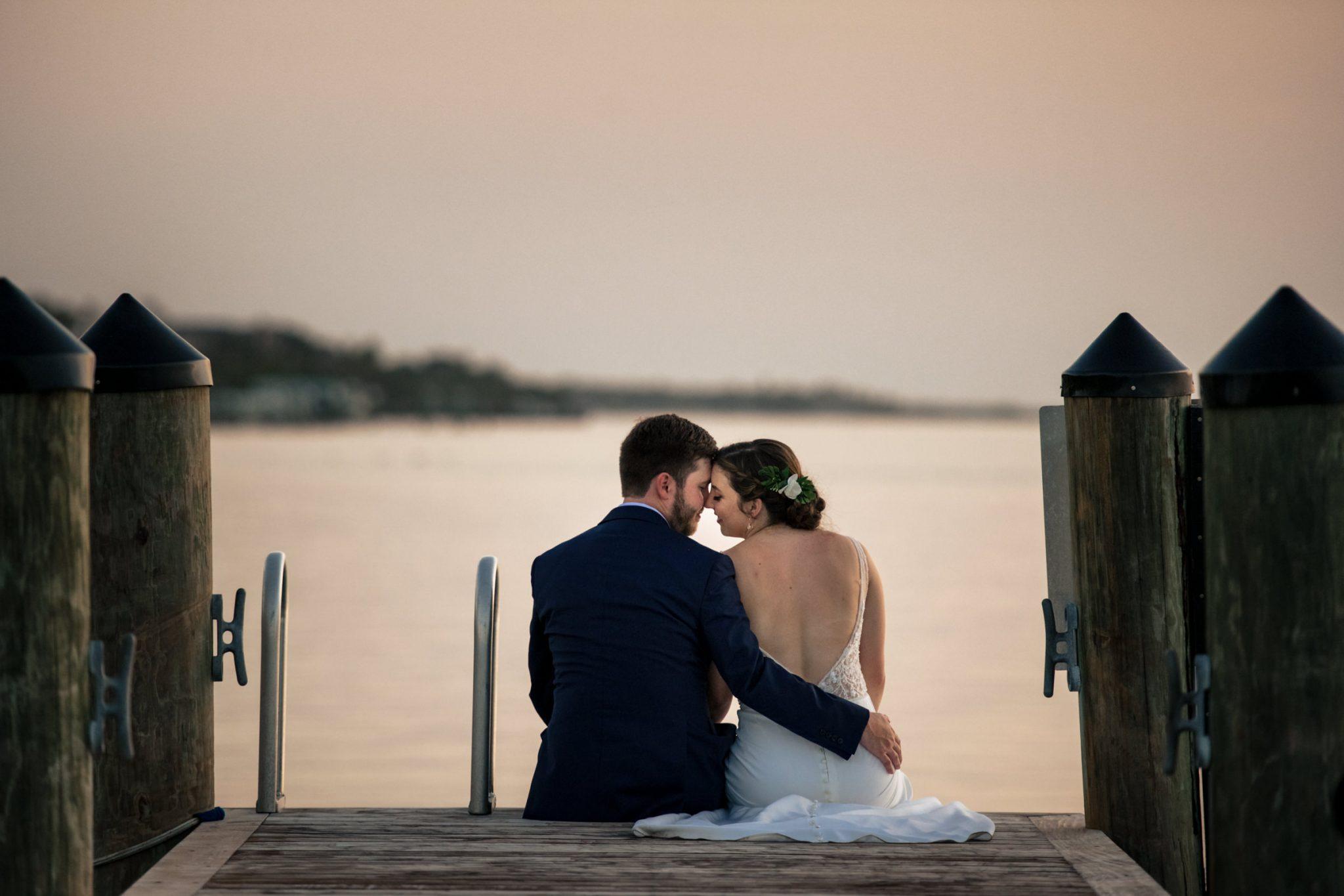 couple kissing at sunset on dock playa largo resort wedding