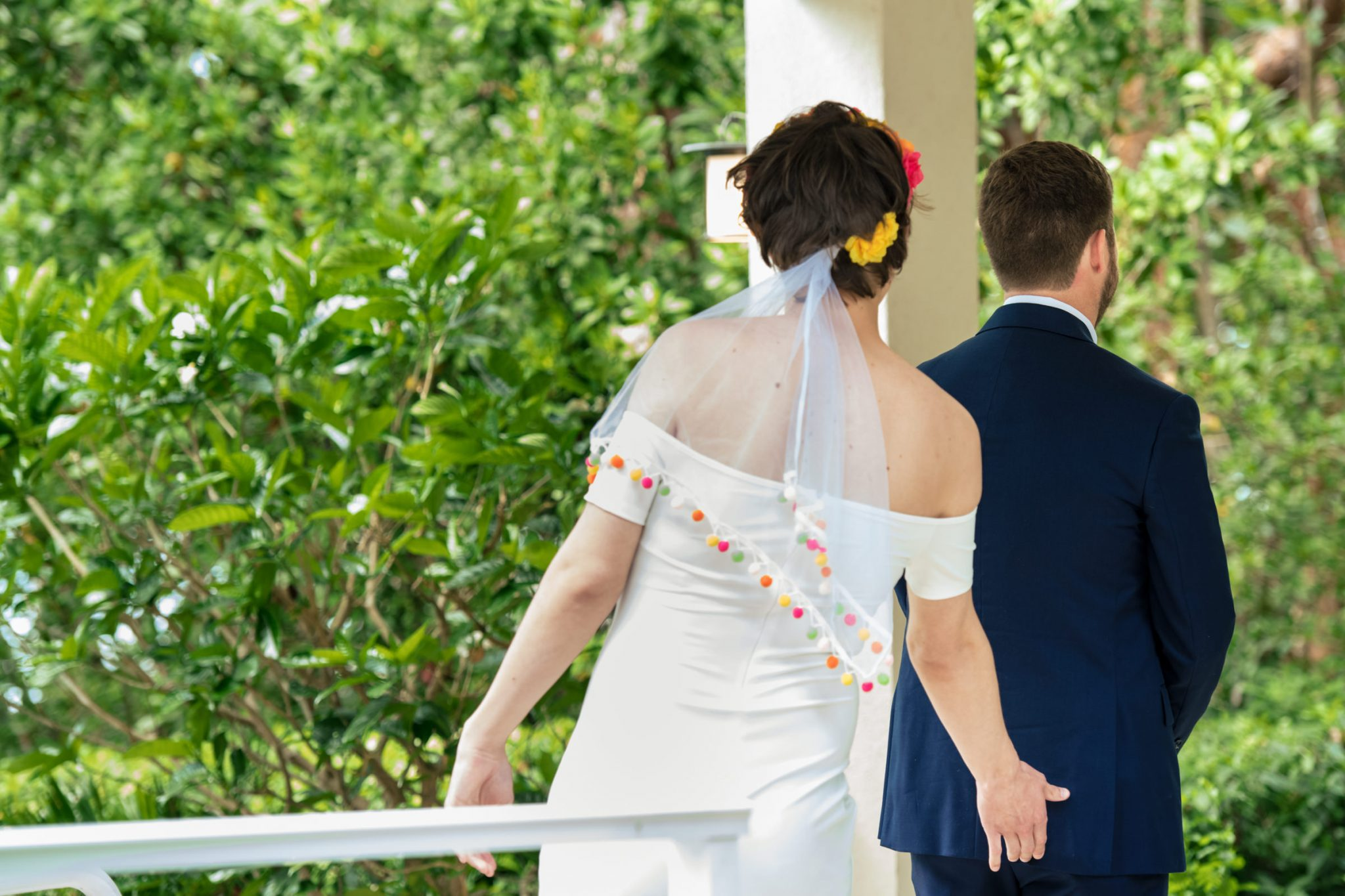 funny first look with groomsmen dressed in wedding dress playa largo resort wedding