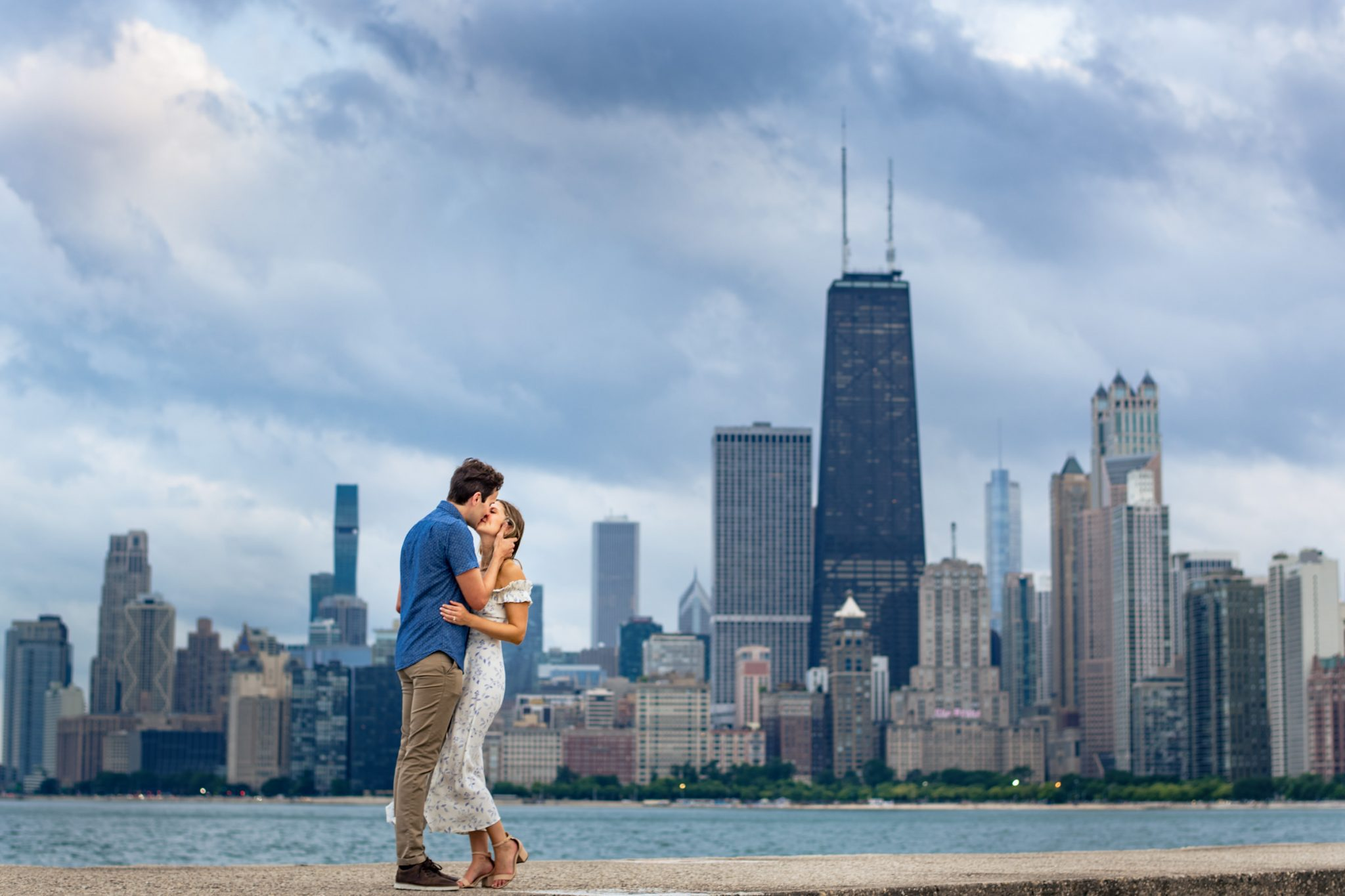 couple kissing at north ave beach during Chicago engagement session