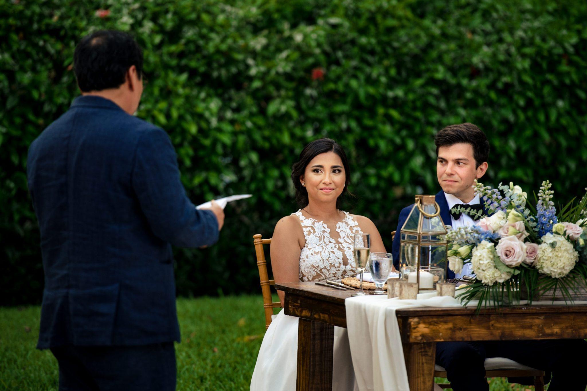 key west wedding couple reacting to fathers toast