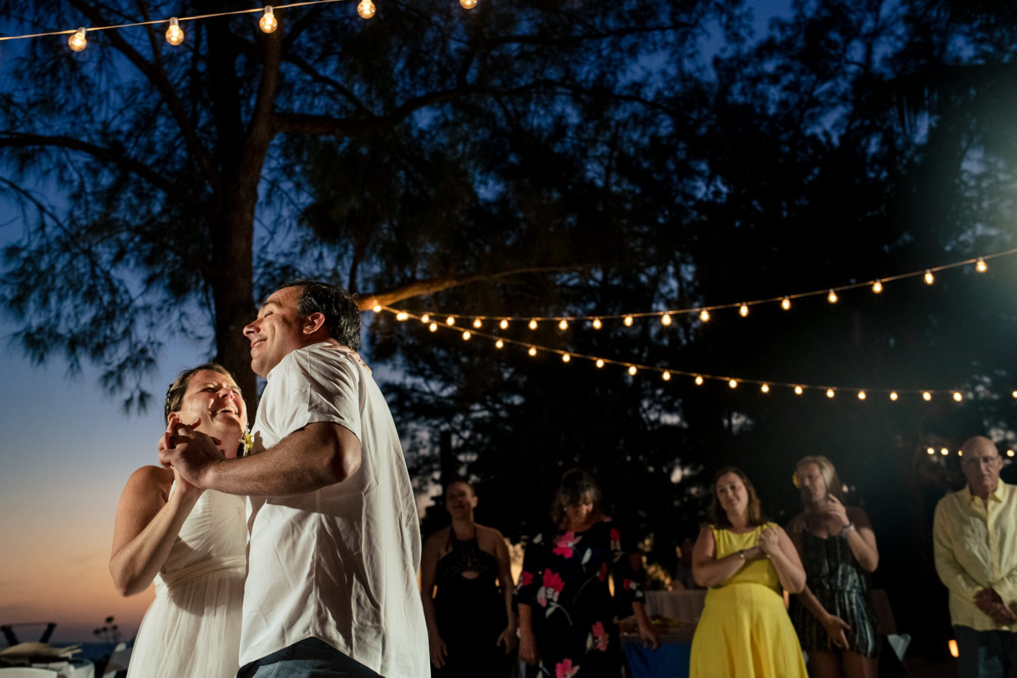 key west wedding couple dancing under palm trees at fort Zachary Taylor