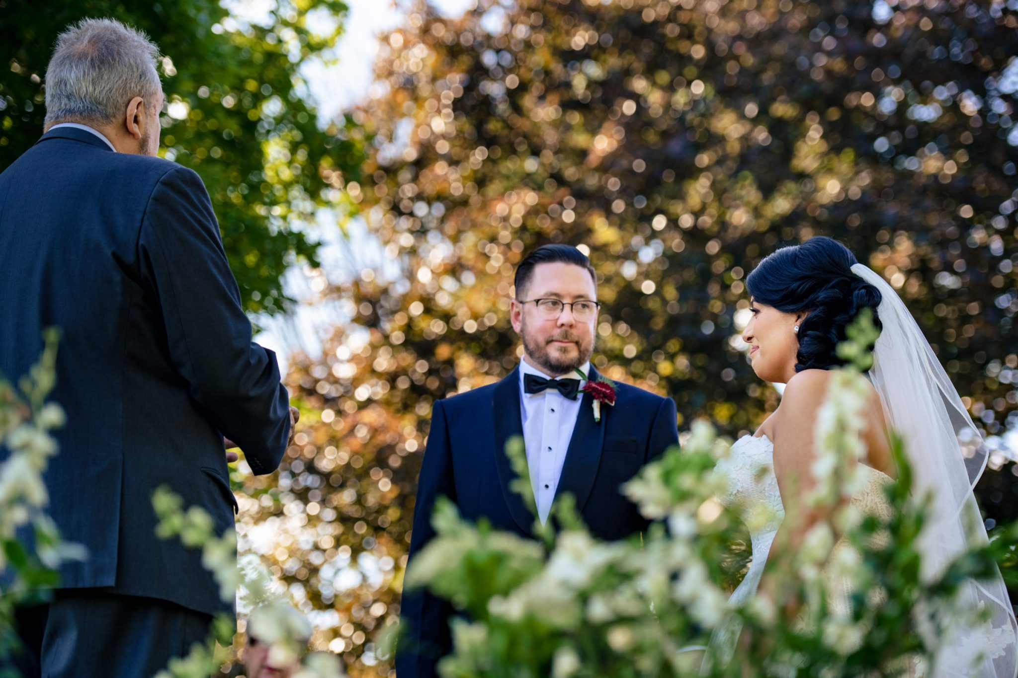 wedding couple during the ceremony having an emotional exchange