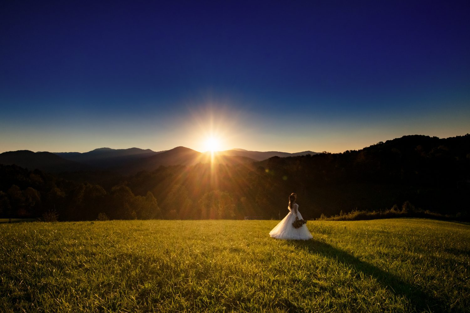 bride and groom at sunset the ridge asheville wedding venue