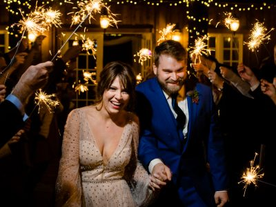 bride and groom exiting wedding reception under sparklers at the twickenham house